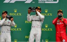 Lewis Hamilton extended his lead at the top of the Formula One championship on Sunday after winning the British Grand Prix for a record sixth time. Picture: AFP.