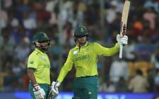 South Africa's Quinton de Kock (right) raises his bat after scoring a 50 in the Twenty20 International match against India on 22 September 2019. Picture: @BCCI/Twitter