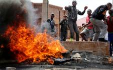 FILE:Bekkersdal residents protest and burn tyres during Gauteng Premier Nomvula Mokonyane's vist. Picture: Sebabatso Mosamo/EWN