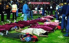 FILE: The bodies of soccer supporters lie on the pitch at Ellis Park Stadium in the worst stadium soccer disaster in South African history on 11 April 2001. Picture: PSL.