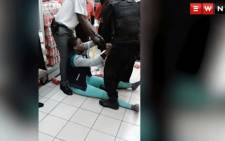 A screengrab shows a mother being assaulted in front of her toddler at a Shoprite store.
