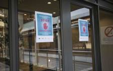 Posters of public guidance to prevent COVID-19 at the entrance of Netcare Milpark hospital. Picture: Abigail Javier/EWN