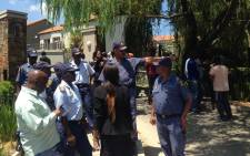 Police, media and EFF members outside a Sandton hotel where suspended EFF MP Andile Mngxitama is expected to brief the media on Tuesday 17 February 2015. Picture: Vumani Mkhize/EWN