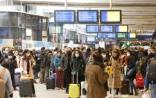 Parisians wait to board their train leaving from the Gare Montparnasse serving the west and southwest of France, in Paris on 19 March 2021. Parisians packed inter-city trains leaving the capital hours ahead of a new lockdown in the French capital imposed to combat a surge in coronavirus infections. Picture: Ludovic Marin/AFP