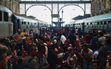FILE: Migrants and refugees crowd the platforms at the Keleti (eastern) railway station in Budapest on 1 September, 2015. Picture: AFP.