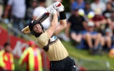 New Zealand's Martin Guptill hits a six during the 2nd cricket T20 match between New Zealand and Australia at University Oval in Dunedin on 25 February 2021. Picture: Marty Melville/AFP