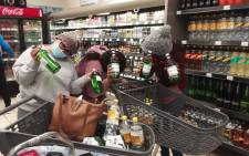 Shoppers pose with their alcohol after the liquor sales ban was lifted on 1 June 2020. Picture: Supplied
