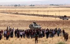 Turkish Kurds gather in Suruc in Sanliurfa province on the Turkish-Syrian border to show support for the people of the Syrian town of Kobane in June 2015. Picture: AFP.