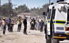 Residents in the township of Seweding near Mahikeng protest for the removal of North West Premier Supra Mahumapelo on 20 April 2018. Picture: Ihsaan Haffejee/EWN