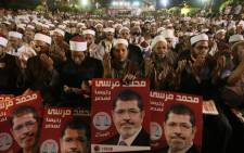Supporters of Mohammed Mursi, the Muslim Brotherhood's candidate in Egypt's presidential election, pray during the party's last campaign rally for Egypt's presidential election, in Cairo on May 20, 2012. Picture: AFP
