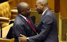 Newly appointed South African President Cyril Ramaphosa (L) is congratulated by Democratic Alliance Party leader Mmusi Maimane (R) after being elected by the Members of Parliament during his swearing in ceremony at the Parliament in Cape Town, on 15 February 2018. Picture: AFP.