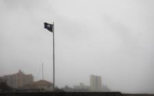 A South Carolina State flag flaps wildly in the wind as Tropical Storm Isaias approaches the South Carolina coastline in North Myrtle Beach, South Carolina on 3 August 2020. Picture: AFP
