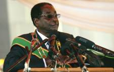 Zimbabwe President Robert Mugabe delivers a speech at the National Heroes Acre in Harare on 12 August 2013 during Heroes Day celebrations. Picture: Jekesai Njikizana/AFP