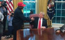 FILE: US President Donald Trump meets with rapper Kanye West in the Oval Office of the White House in Washington, DC, on 11 October 2018. Picture: AFP