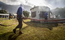 FILE. Firefighters douse one of the cottages which caught fire at Oatlands Holiday Village in Simon's Town on 19 November 2015. Picture: Aletta Harrison/EWN