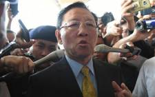 Expelled North Korean ambassador to Malaysia Kang Chol speaks to journalists outside the departure hall of the Kuala Lumpur International Airport in Sepang on March 6, 2017. North Korea's ambassador was escorted by a motorcade of armed police to the Kuala Lumpur airport on March 6 after being expelled in a deepening diplomatic dispute over the assassination of the half brother of Pyongyang's leader. Picture: AFP.