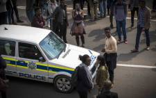 FILE: A lone student prevents a police vehicle from exiting the campus after the FeesMustFall movement shut down Wits campus after Minister of Higher Education Blade Nzimande failed to deliver a free tertiary education policy. Picture: Thomas Holder/EWN.