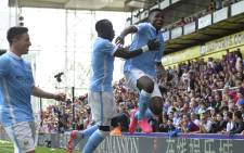 Manchester City's Nigerian striker Kelechi Iheanacho (R) celebrates scoring the winning goal during the English Premier League football match between Crystal Palace and Manchester City at Selhurst Park in London on September 12, 2015. Picture: AFP.