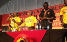 Numsa leadership (with Andrew Chirwa at far right) with suspended Cosatu Secretary General Zwelinzima Vavi (second from right) at the union's special congress, 18 December 2013. Picture: Govan Whittles/EWN.