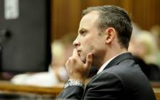 FILE: Oscar Pistorius watches proceedings during the first day of his murder trial on 3 March 2014. Picture: Pool.