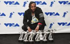 Kendrick Lamar with his MTV VMA awards. Picture: AFP