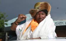 FILE: Nepali mountaineer Kami Rita Sherpa, 48, who broke his own world record for the most Everest summits, gestures after arriving in Tribhuvan airport in Nepal's capital Kathmandu on 20 May 2018. Picture: AFP