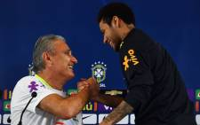 Brazil's Neymar (R) shakes hands with team coach Tite (L) during a press conference after a training session on the eve of their 2018 FIFA Russia World Cup qualifier. Picture: AFP