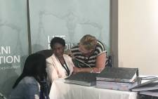 Hanna Jacobus is comforted during a break of her testimony at the Esidimeni arbitration hearing on 19 December 2018. Picture: Masego Rahlaga/EWN