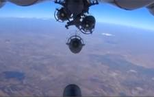 FILE: A camera on the belly of a plane shows a Russian plane dropping a bomb over Syria. Picture: Screen grab/CNN.