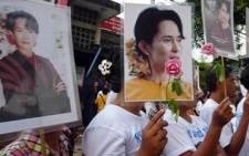 Supporters of Myanmar's opposition leader Aung San Suu Kyi outside the National League for Democracy headquarters on 12 November 2010. Picture: AFP