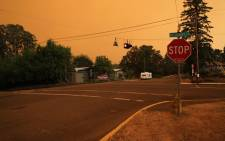 An orange smoke-filled sky is seen above Estacada, Oregon, on 9 September 2020, as fires burn nearby. Picture: AFP.