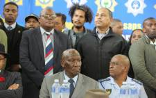 Police Minister Bheki Cele (left) and Western Cape Provincial Police Commissioner Khombinkosi Jula meet with Bonteheuwel residents on 26 September 2018 to address their concerns following anti-gang violence protests. Picture: SAPoliceService/Twitter