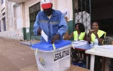 A voter casts his ballot at a polling station in Bissau on 10 March 2019, during the legislative elections in Guinea Bissau. Picture: AFP.