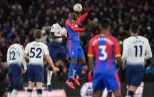 Tottenham Hotspur's Colombian defender Davinson Sanchez (3L) and Crystal Palace's Zaire-born Belgian striker Christian Benteke (3R) jump to head the ball during the English FA Cup fourth round football match between Crystal Palace and Tottenham Hotspur at Selhurst Park in south London on 27 January 2019. Picture: AFP.