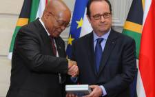 President Jacob Zuma receives digitised Rivonia Trial dictabelts from French President Francios Hollande. Picture: GCIS.