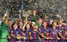 Barcelona's players celebrate after the UEFA Champions League Final football match between Juventus and FC Barcelona at the Olympic Stadium in Berlin on 6 June, 2015. Picture: AFP.
