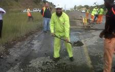 FILE: Gauteng Roads and Transport MEC Ismail Vadi gets his hands dirty at the launch of his department's emergency road maintenance campaign. Picture: Sapa.
