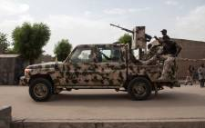 FILE: A Nigerian army vehicle patrols in the town of Banki in northeastern Nigeria on 26 April 2017. Picture: AFP