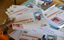 A polling station worker counts ballots during the second round of the presidential election at the polling station in Niamey on 20 March, 2016. Picture: AFP.