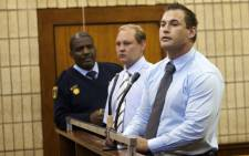 (L) Zane van Tonder and Rudolph Viviers (R) appear in the Krugersdorp Magistrate's Court on Tuesday, 21 August 2012 on murder charges after the death of Mohammed Fayaaz Kazi from Ventersdorp. Picture: Sapa
