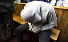 Nicholas Ninow, who is accused of raping a seven-year-old girl in a Dros restaurant, appears in the Pretoria Magistrates Court on 2 October 2018. Picture: Christa Eybers/EWN.