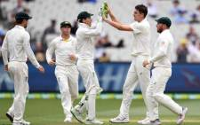FILE: Australia's paceman Pat Cummins (2nd R) celebrates the dismissal of India's batsman Hanuma Vihari with teammates during day three of the third cricket Test match between Australia and India in Melbourne on 28 December 2018. Picture: AFP