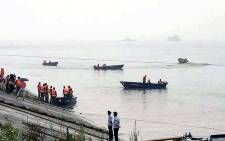 Chinese rescue teams head out to search for survivors of a passenger ship which sunk in the Yangtze River on 1 June 2015. Picture: China Out/AFP
