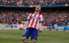 Atletico Madrid's midfielder Saul Niguez celebrates after scoring his team's second goal during the Spanish league football match Club Atletico de Madrid vs Real Madrid CF at the Vicente Calderon stadium in Madrid on 7 February, 2015. Picture: AFP
