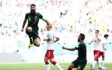 Australia's Mile Jedinak celebrating scoring a goal against Denmark during their World Cup match. Picture: Facebook.com.