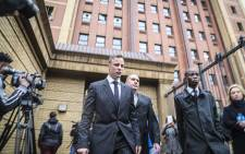 Convicted murderer Oscar Pistorius leaves the High Court in Pretoria for an adjournment during sentencing arguments on 13 June 2016. Picture: Reinart Toerien/EWN.