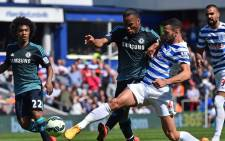 Chelseas Ivorian striker Didier Drogba (2nd L) vies with Queens Park Rangers English defender Steven Caulker during the English Premier League football match between Queens Park Rangers and Chelsea at Loftus Road Stadium in London on 12 April, 2015. Picture: AFP