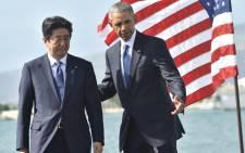 US President Barack Obama (R) speaks with Japanese Prime Minister Shinzo Abe. Picture: AFP.