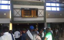 FILE: Commuters check the electronic notice board at Metrorail's Cape Town Station. Picture: Xolani Koyana/EWN.