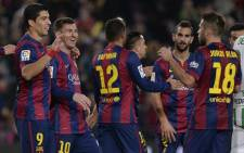 FILE: Barcelona's players celebrate after the UEFA Champions League Final football match between Juventus and FC Barcelona at the Olympic Stadium in Berlin on 6 June, 2015. Picture: AFP.